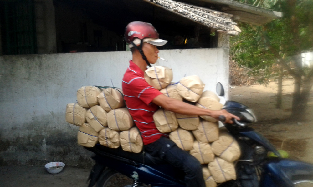 Scooter in Vietnam carrying loads of rice noodles