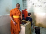 water blessing, monk, siem reap, cambodia