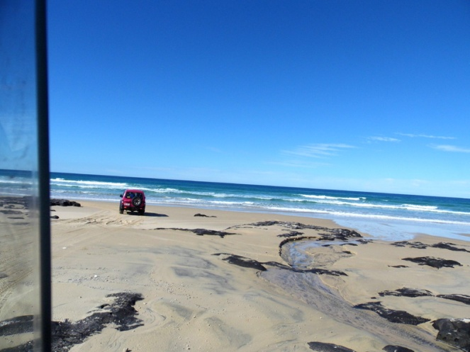 Driving onto the 75 mile beach highway, Fraser Island, Australia