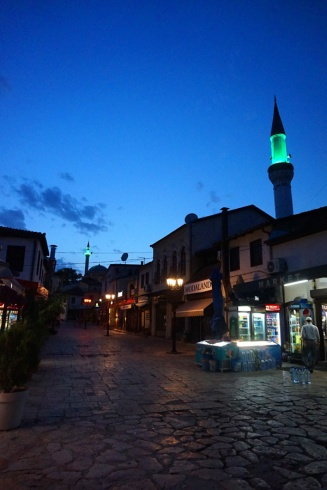 Skopje at night with minarets lit up, North Macedonia
