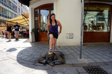 Me standing on the Man At Work statue, Bratislava, Slovakia