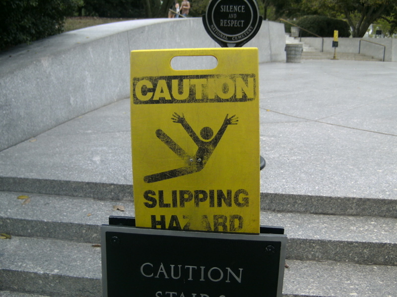 Silly slipping hazard sign, Arlington Cemetery, USA