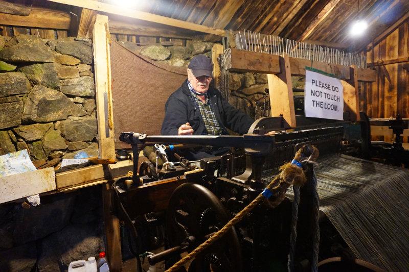 Ali with the tweed loom at Gearrannan Blackhouse Village, Isle Of Lewis, Scotland